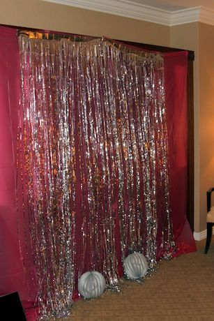 2 tablecloths, 2 silver fringe curtains = tinsel photo shoot backdrop