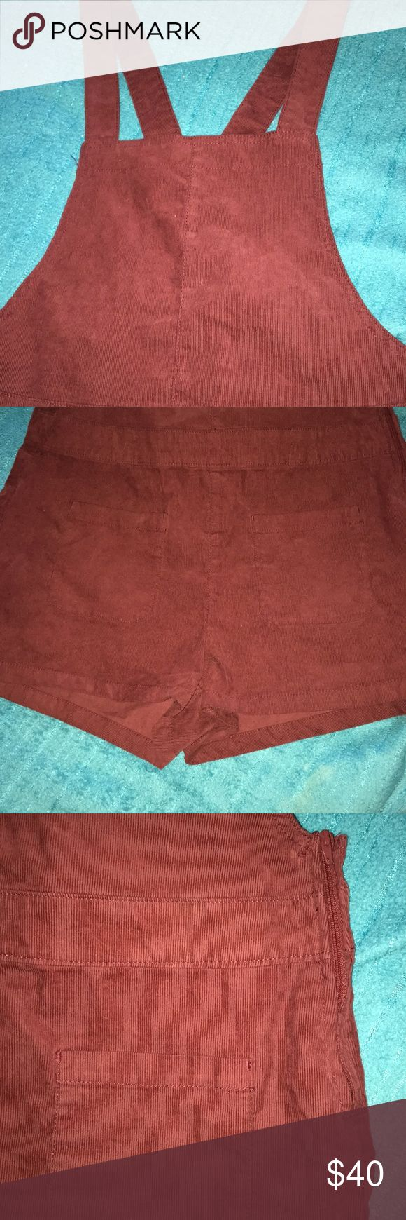 Dark maroon shorts overalls from H&M Overall shorts very cute and stylish! Has two front pockets and also adjustable straps in the back as shown in picture and also a zipper along the side. Color looks a bit lighter in pics but is like a darker maroon color. Still has tags, never worn! Size 12 (: H&M Other