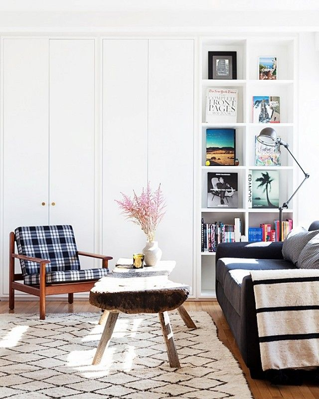 Living room with a vintage rug, a wood coffee table, and a reading lamp