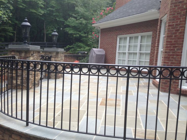 Raised Bluestone Patio W Wrought Iron Rails And Stacked