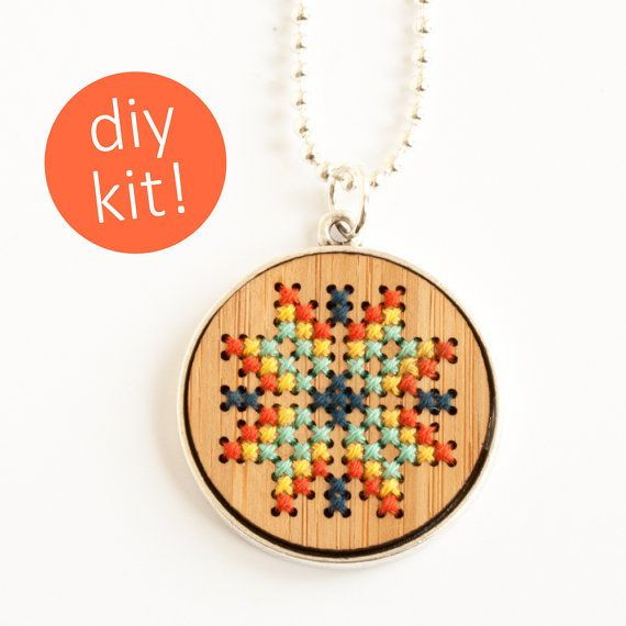 This DIY kit has everything you need to create your own cross stitch necklace! A bamboo round is hand embroidered in your choice of colorful folk art inspired cross stitch patterns and then set into a silver-plated frame for the perfect finishing touch.  Each pendant measures just under 1-1/2 inches in diameter. The wood piece is made from eco-friendly bamboo and comes with pre-cut holes that are a breeze to stitch into. Each kit comes with four cross stitch patterns so you can choose your…