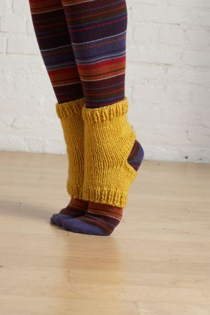 Yoga Socks knitting pattern. This pattern is published by Lion Brand Yarns, and is available for download.
