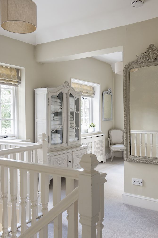 French-style touches include this French armoire on the upstairs landing #interiors #WTinteriors