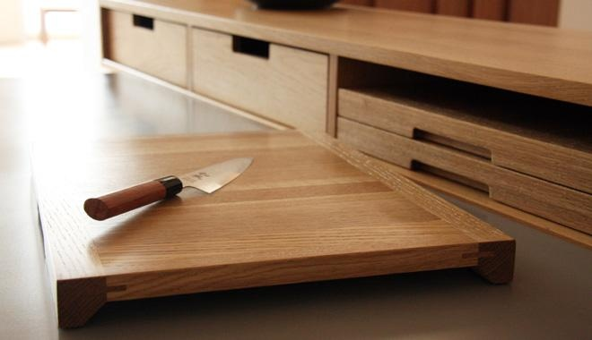 Each type of food has it's own cutting board. I would burn the type into the edge, but these routed pulls are great, too.