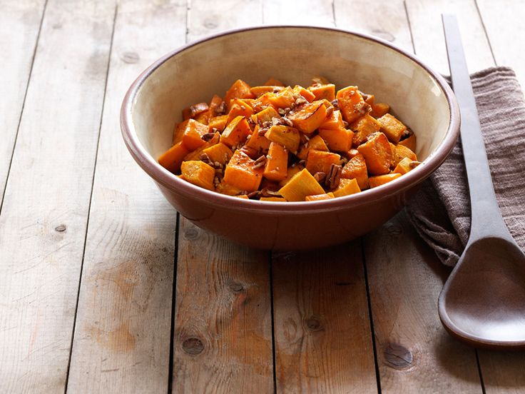 Roasted Sweet Potatoes with Pecans and Spiced Maple Sauce recipe from Aida Mollenkamp via Food Network