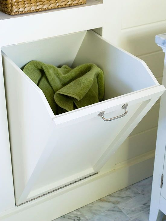 Laundry Solution Problem: You lack floor space to store a hamper for dirty laundry.    Solution: Put empty wall space to work. A handy tilt-out bin does the trick in this bathroom. Although it's small, the bin offers a convenient storage solution to keep dirty laundry out of sight.