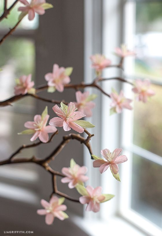 Make your own crepe paper cherry blossom branches, perfect as a centerpiece for a wedding, baby shower or your dinner table. Pattern and tutorial here.