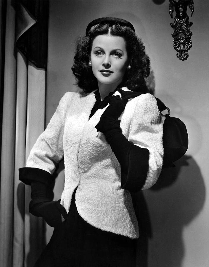 Hedy Lamarr wearing gloves in the 1944 film Heavenly Body.