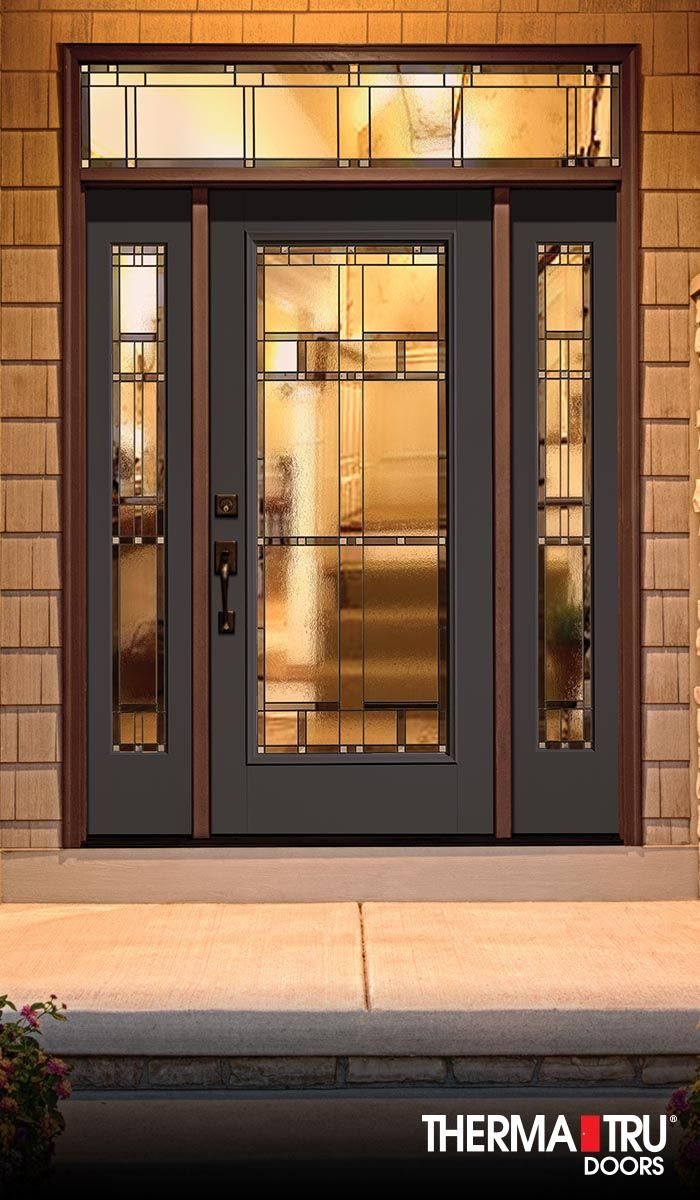 Therma-Tru Classic-Craft Canvas Collection fiberglass door painted Naval with Homeward decorative glass.