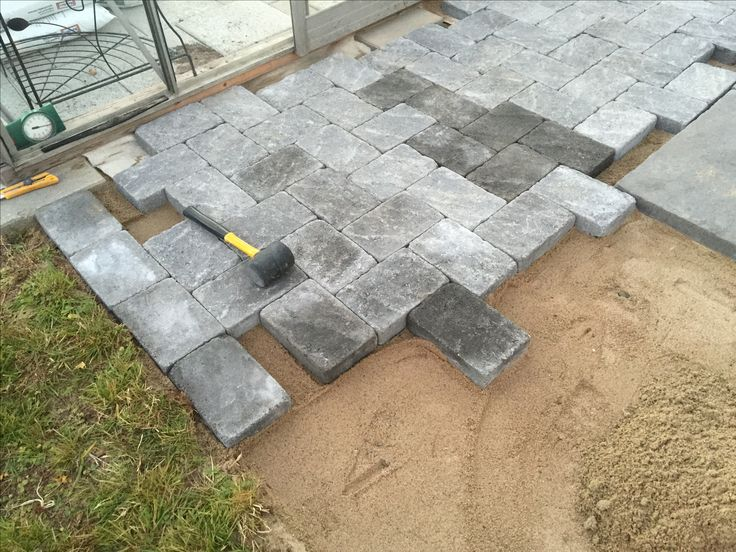 Making of Pavered path using Benders Troja Antik Graphite and Labyrint side of same brick as border.
