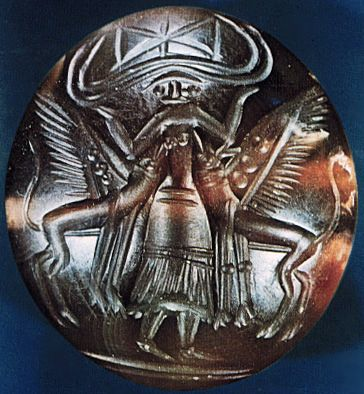 """A horned goddess flanked by griffins who are nursing at her breasts on the seal known as Potnia, after the Linear B inscriptions to Po-ti-ni-ya, the Lady. The archetype on this seal, often seen in west Asian art, is often called """"the Mistress of Beasts,"""