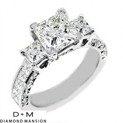 Three stone princess cut....almost perfect!  Put baguettes down the sides instead of princess and its beautiful!