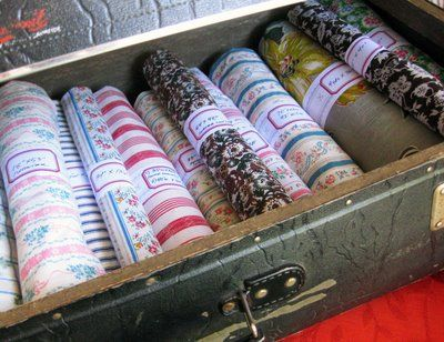 Creative way to store extra fabric - she even gives you a PDF for the labels to make them yourself.