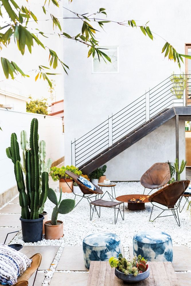 Outdoor Patio Space with Rattan Style Seating and Cactus Plants