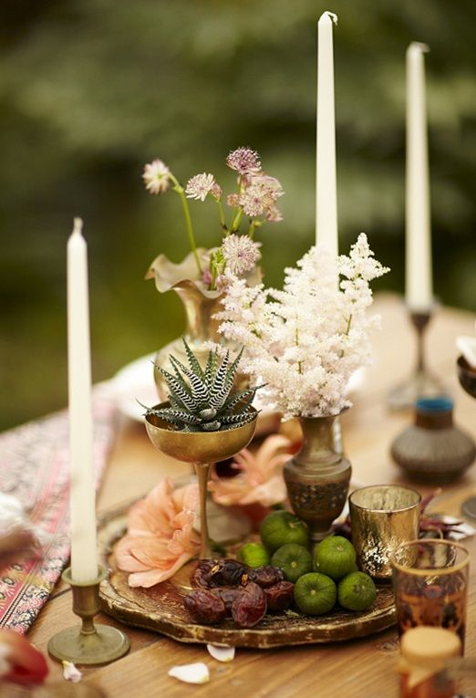 Deep jewel coloured flowers, succulents and old brass vases for a touch of Bohemian