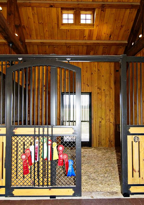 high stall front stall design with bar top vented wood and crosshatch mesh bottom euro style center and bottom rails and arched door - Horse Stall Design Ideas