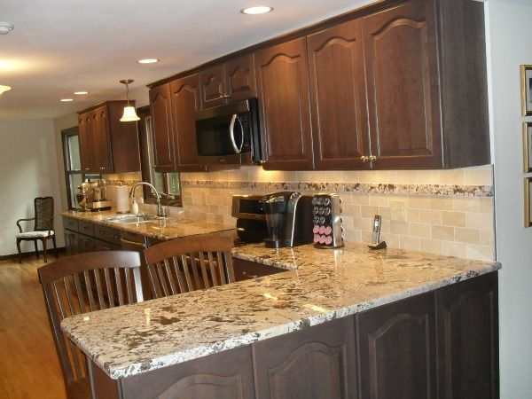 Remodeled Kitchen With Cathedral Arch Raised Panel Cabinet Doors By