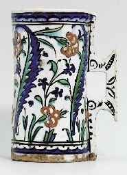 AN IZNIK POTTERY CYLINDRICAL MUG