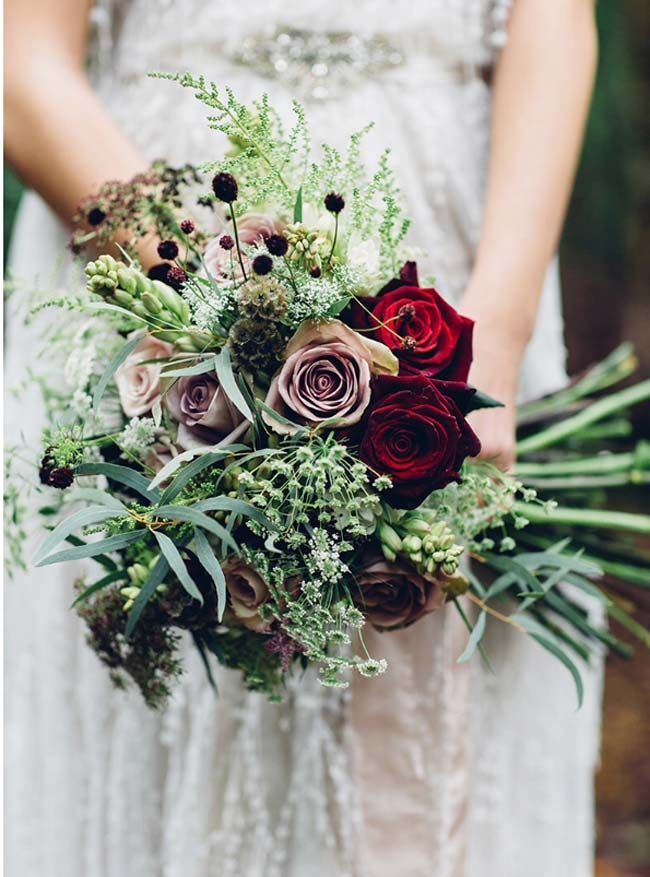 This vintage bridal bouquet from The Flower Bird has a gothic feel to it with the deep red roses