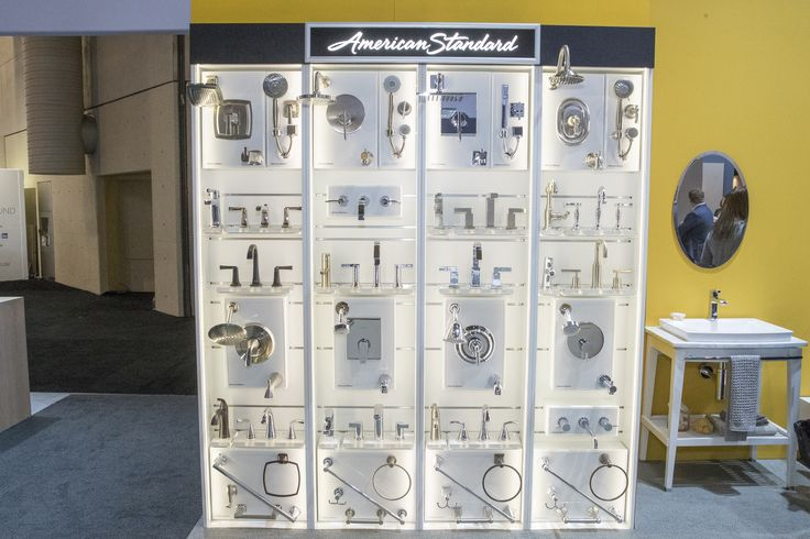 Samples of some American Standard bathroom fittings including shower heads and matching sink faucets.