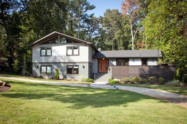 modern split level facade exterior midcentury with turf black fence and gate hardware