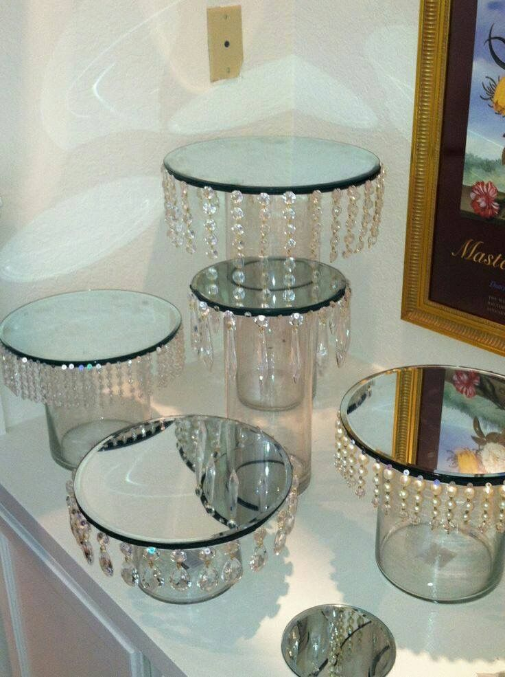 I have square mirrors you can glue beads onto. I found some chandelier beads like this at arnes!