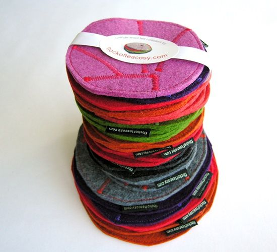 Coasters with a conscience.  Smart coasters, trivets and hotpads made from the offcuts of thick colourful wool felt from making the tea cosies.  Gifts $25 and under.  #holiday #gift #hostess #inexpensive #colorful #colourful #coaster #set #trivet #hotpad #natural #fiber #fibre #eco #concious #living #upcycle #recycle #design #handmade #scrap #friendly #thinking #clever #berecycled
