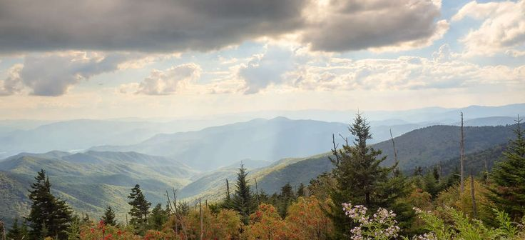 Great Smoky Mountains National Park - Visit Clingmans Dome, the tallest peak in the Great Smoky Mountains. On top of the mountain is a 375-foot spiral ramp that leads to a covered deck, which means you get 365-degree panoramic views of the mountains.