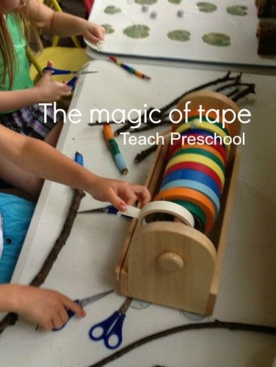 The magic of tape. Fine motor/creativity activity - Tape ripping art w toddlers (lol, minus the scissors).