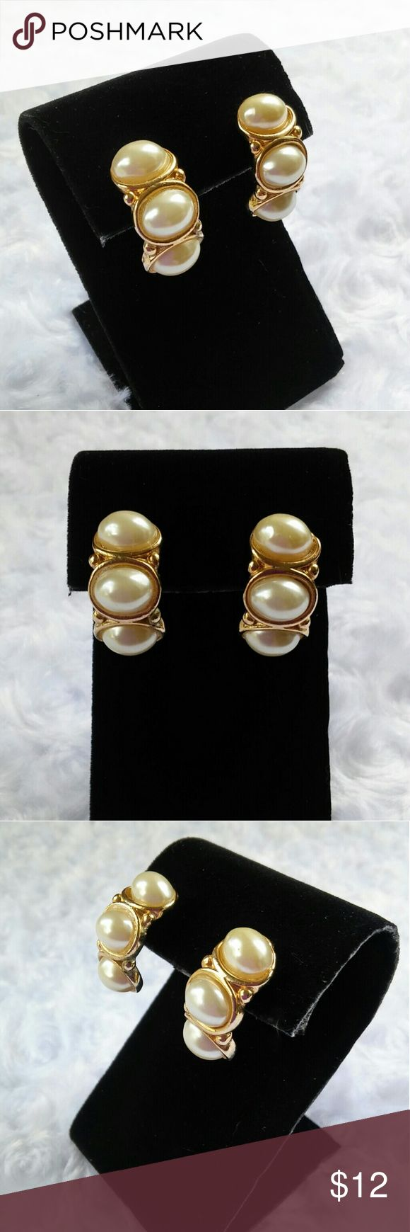 """Faux Pearl Vanish In Hoop Earrings These semicircular earrings have 3 oval faux pearl cabochon set in gold tone metal. Post back. In excellent used condition, no finish loss on the metal or pearls. They measure 1"""" in length and 1/2"""" wide. These are high quality costume jewelry purchased at Macy's. Jewelry Earrings"""