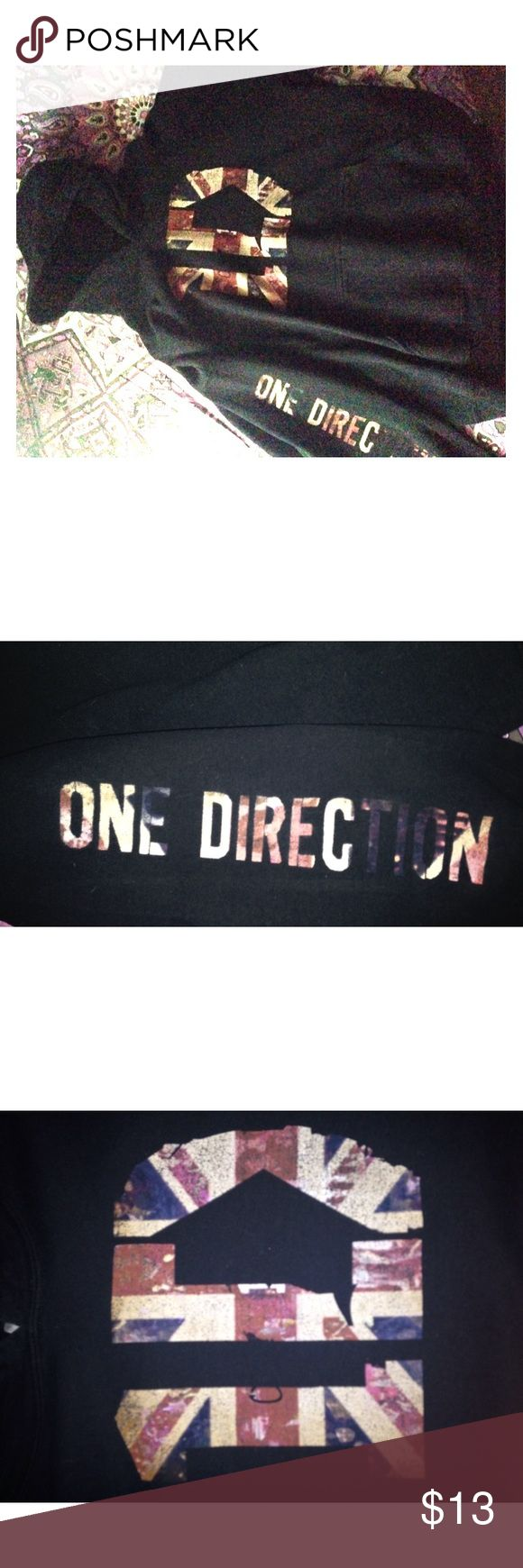One Direction (1D) black hoodie One Direction logo in large on the chest of the hoodie, 'One Direction' printed along the right sleeve, printing in the color of red white and blue (Britain's flag), pocket in the front, worn only once Tops Sweatshirts & Hoodies