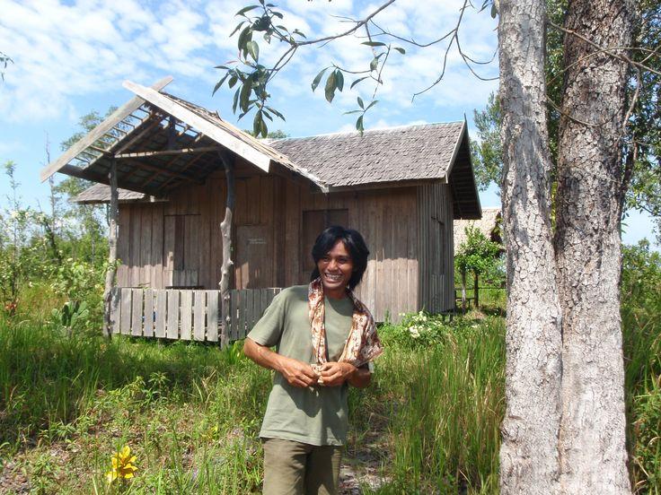 Our general manager in Kalimantan, Basuki Budi Santoso in front of our base camp at Jerembun, near Tanjung Puting National Park.