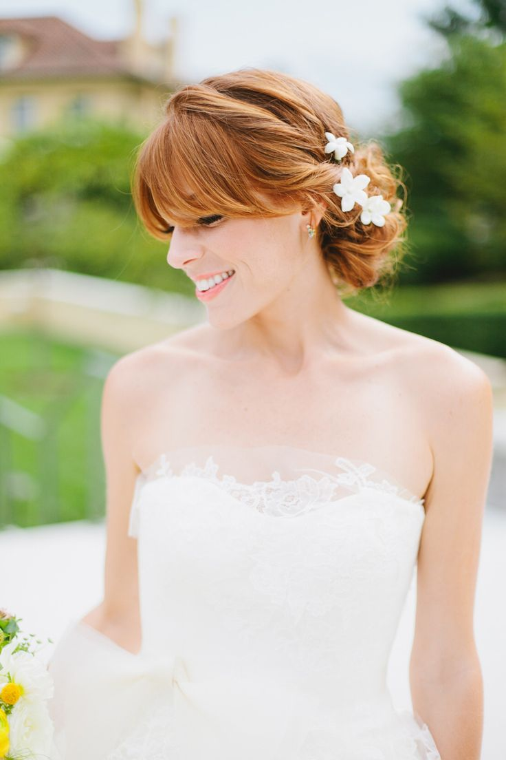 Bangs + Low Bun + Florals = LOVE. #hairstyles  Photography: Morgan Trinker - morgantrinker.com  View entire slideshow: 20 Fresh Flower Hairstyles for Spring + Summer on http://www.stylemepretty.com/collection/271/