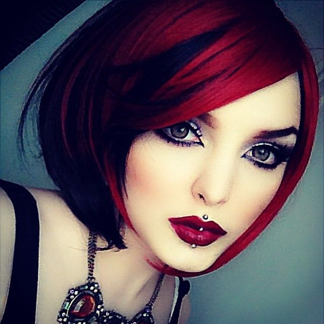 A bit way too extreme for real life, but, I do LOVE this look. The red hair, the makeup... flawless....
