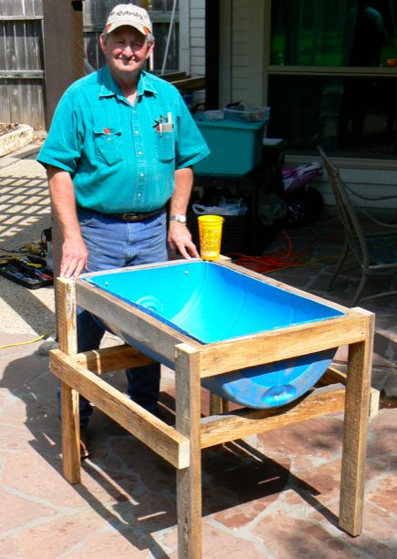 I had been thinking of building a feed trough style worm bed for some time. I found some plastic 55 gallon drums on Craigslist. My dad had some pine 2X4s cut from his saw mill, and we were in bus…
