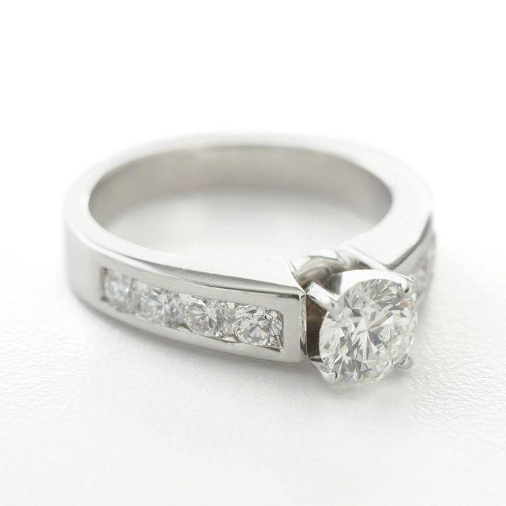 18K white gold, round centre diamond, channel set side diamonds