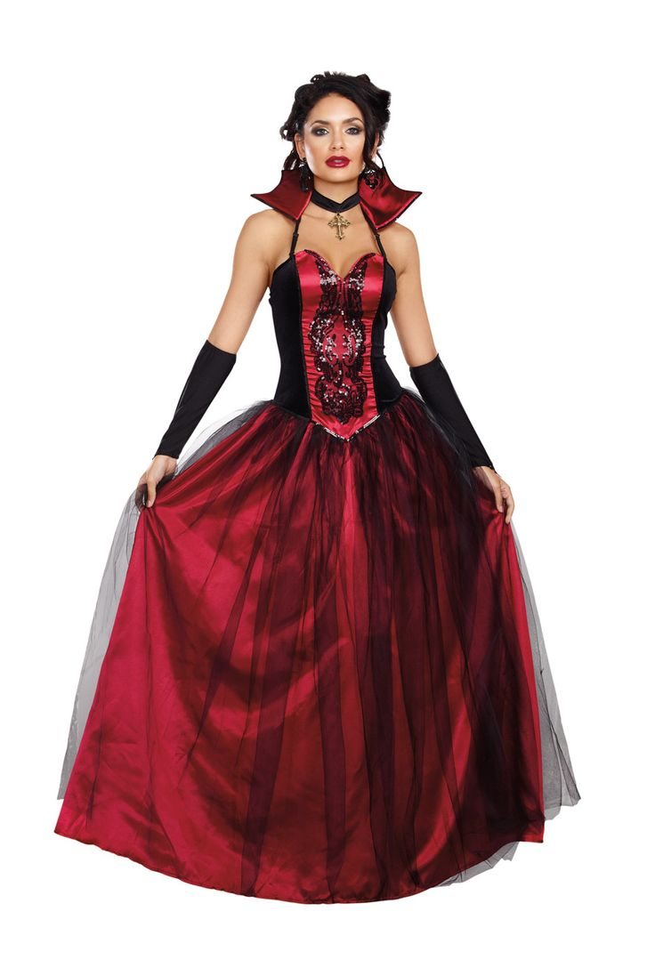 An exquisite gown with velvet and satin bodice featuring a sequin appliqué and full layered satin and tulle skirt.