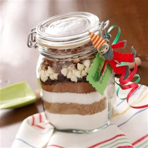 Sand Art Brownie Mix Recipe -These brownies are so good and I always keep a few jars on hand to add to gift baskets or use as hostess gifts. The jars can be decorated by covering the lids with holiday material and tying a ribbon around the top to hold it in place. —Claudia Temple, Sutton, West Virginia