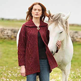 Irish Sweater Jacket modeled with horse, in a color some may call Marsala...