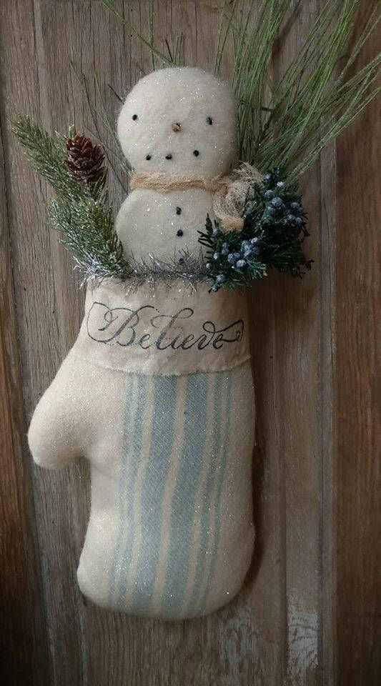 Farmhouse decor Farmhouse style snowman Snowman Believe snowman Snowman in mitten 15-16~ Mittten & snowman made of vintage felted wool. I stamped BELIEVE onto a strip of stained muslin. Greens, preserved juniper & a pinecone are tucked into the mitten. All dusted with mica. This is not a regular size mitten, it is much larger & would be nice on your door or hanging on a white chippy cupboard.  Prices do not include shipping. Use the calculated shipping, if after item is made &...