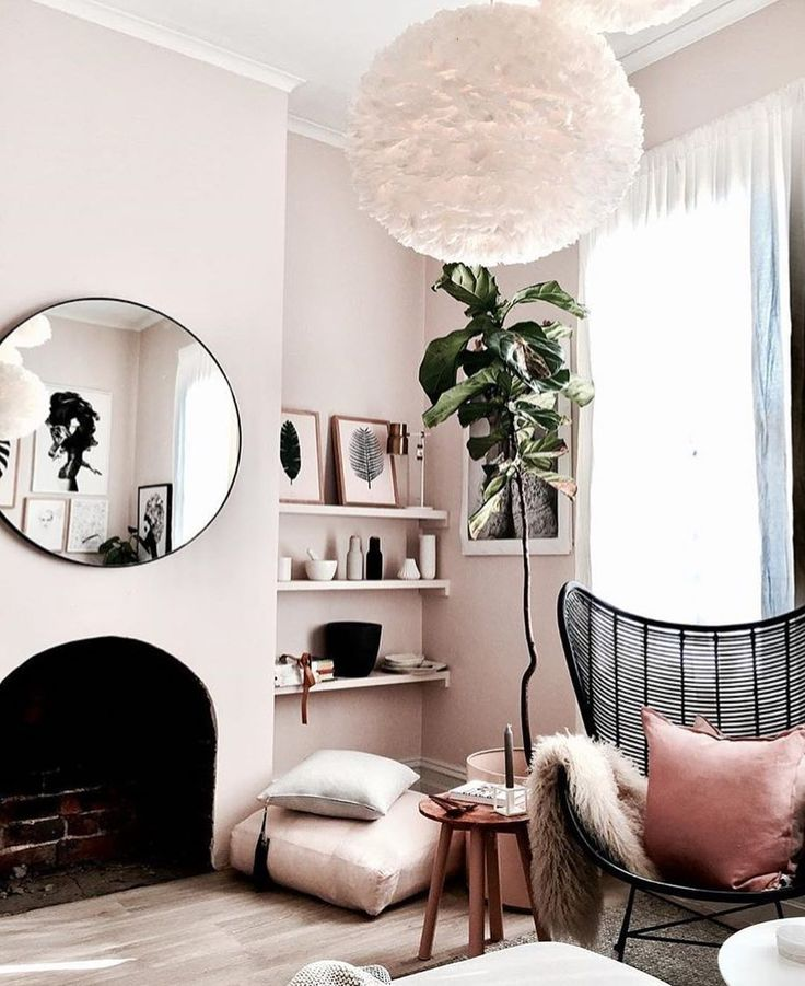 Palest pink walls and round mirror over fireplace #livingroomideas