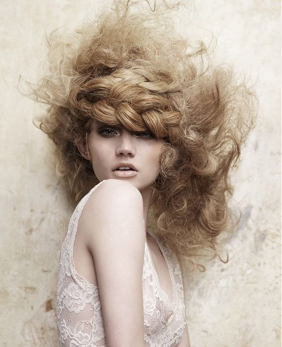 Alexander Hair and Beauty - big statement shapes with braids as a theme referencing traditional folklore styles.