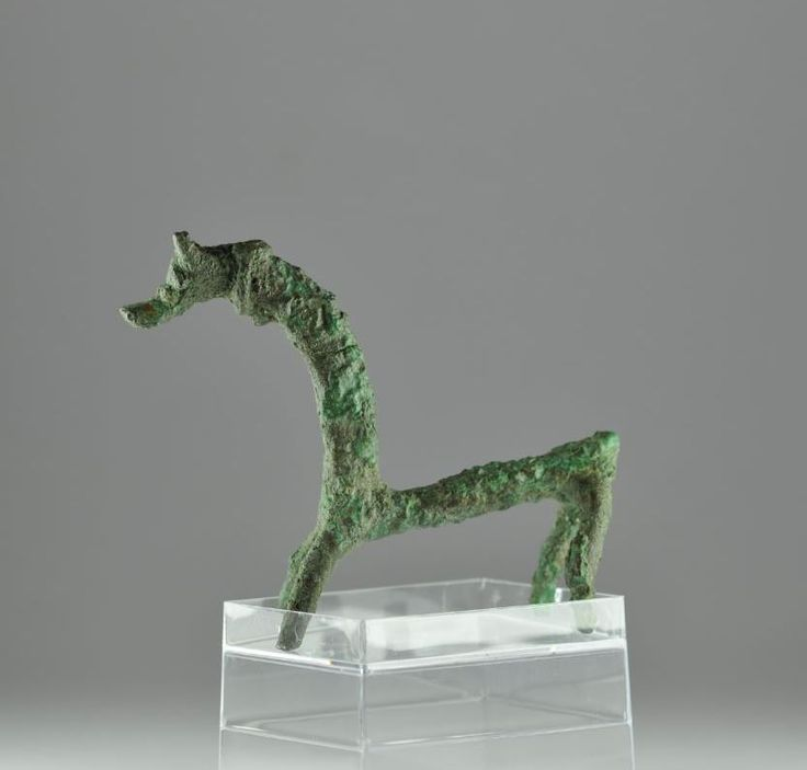 Greek bronze horse, Luristan Iranian bronze horse, 1600-1000 B.C. Greek bronze horse, Iran, Sakkizabad, bronze cast statuette of a horse with narrow cilindrical body and tall curving neck, a horse very like this has been reported from clandestine excavations at Sakkizabad (Art Iranien Ancien, 1966, plate 106), 8.4 cm long. Private collection