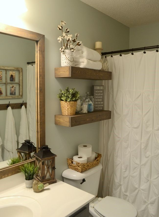 gray bathroom with wood floating shelves