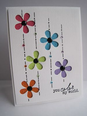 Die cut out each flower, hand draw lines and dots with ruler...add polka dotted embossed paper behind each die cut and add stick on dot...rhinestones dotted on line of each color.