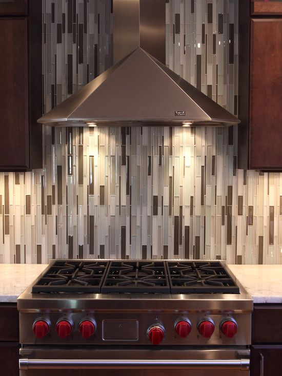 Vertical glass tiles | Designed by Normandy Remodeling | Opera Glass Collection Serenade Stilato.