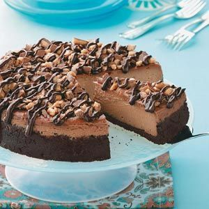 Coffee Toffee Cheesecake Recipe -My husband and I host both sides of our families on Thanksgiving every year. I came up with this candy-topped cheesecake a few years ago, and everybody went nuts over it. —Tammy Baker, Bowling Green, Kentucky