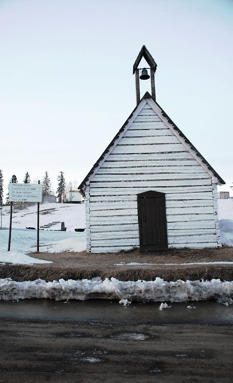 The Old Anglican Church of Tulit'a, Northwest Territories. This church is an official historic site because it was built in 1880 and is one of the oldest standing buildings in the Northwest Territories.