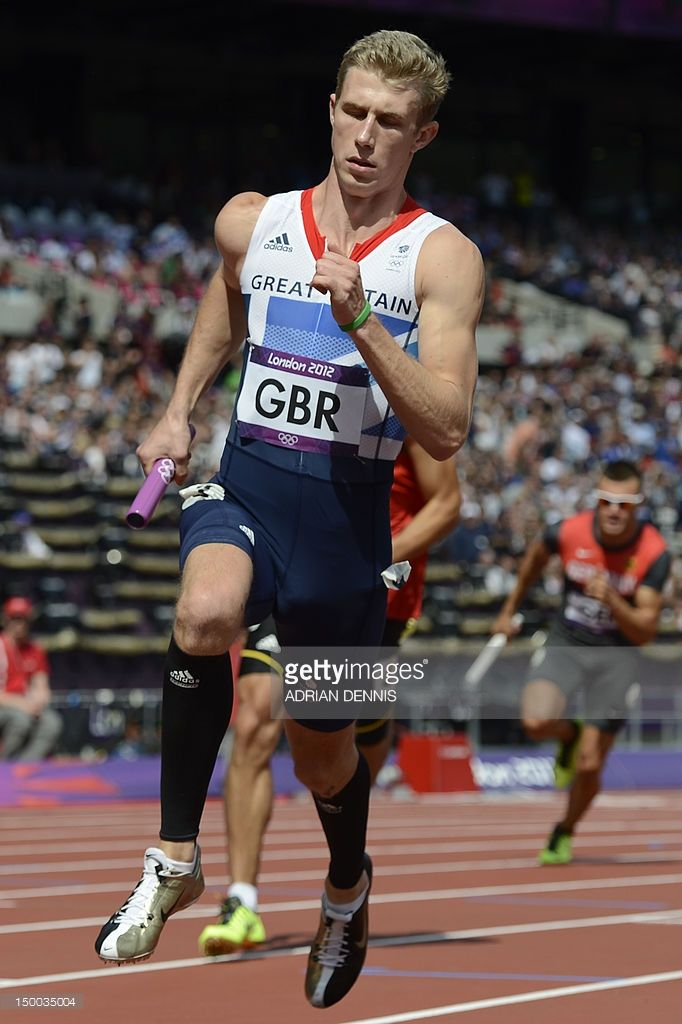 Britain's Jack Green runs with the baton in the men's 4X400m relay heats at the athletics event during the London 2012 Olympic Games on August 9, 2012 in London.