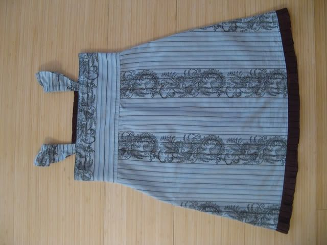 a shirt easily made into a childs dress....hmmmm, i need to be on the lookout for cute printed shirts at yardsales!